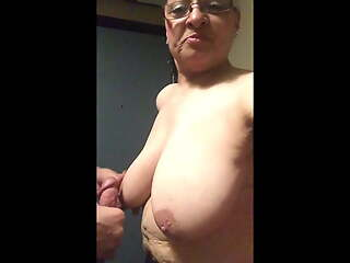 Standing titfuck of older woman with big long tits